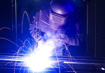 Welder on the workplace. Construction and manufacturing