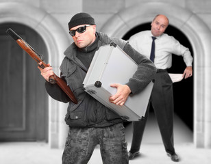 Street assault or bank robbery. Gangster and his victim.