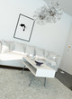 Light living room interior with white furniture