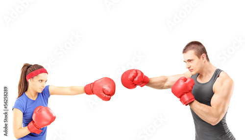 Female and male boxers with boxing gloves during a match
