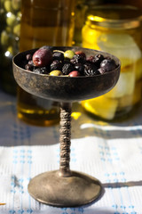 Fresh and Dry Olives in an Old Dish
