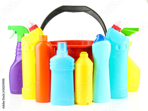 Colorful plastic detergent bottles with bucket, isolated