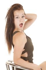girl looking over shoulder shocked