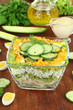 Delicious salad with eggs, cabbage and cucumbers on wooden