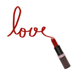 close up of lipstick with word love on white background