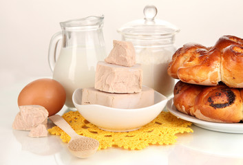 Dry yeast with pastry and baking ingredients isolated on white