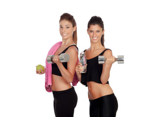 Beautiful friends training lifting weights