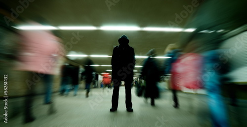 Black silhouette standing in crowd - 56261432