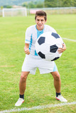 Soccer Player with Funny Big Ball