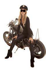 Woman cop motorcycle sit side