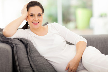 pregnant woman resting on a sofa