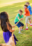 Kids Playing Tug of War On Grass