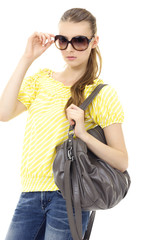 fashion model wearing modern sunglasses with handbag posing