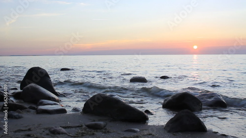 sunset at the horizon rocky beach at beautiful Baltic Sea, 1080
