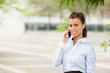 Brunette businesswoman is phoning