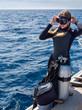 Beautiful Woman in Preparation for Scuba Diving - 56267455