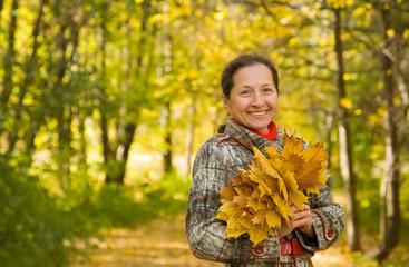 mature woman  in autumn