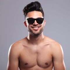 topless man smiles for you
