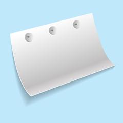 лист с металлическими кнопками на синем фоне