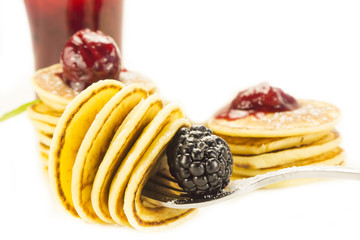 sweet little pancakes with blackberry jam