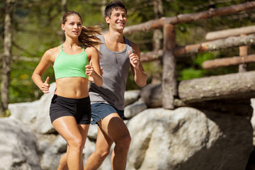 Young sporty couple is doing running exercises