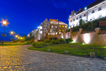 Granaries and water gate in Grudziadz at night, Poland