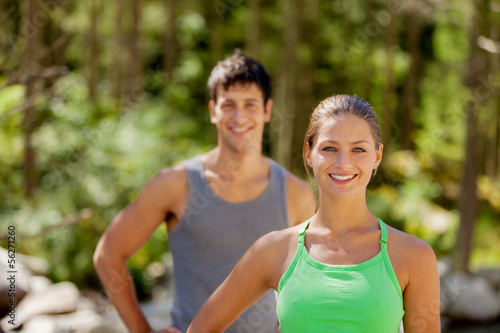 Athletic couple in the mountains with sporty outfit