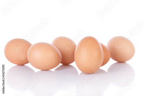 Half dozen  brown chicken eggs isolated on white background