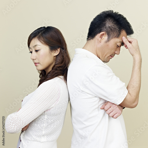young asian couple having relationship difficulties