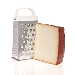 Grater and Cheese isolated on white background