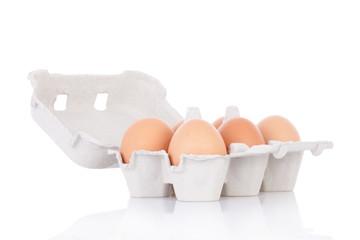Half dozen  brown chicken eggs in box