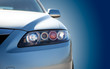 canvas print picture - blue modern car closeup