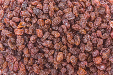 Crimson Raisins background texture close up detail.