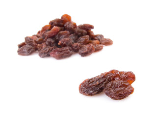 Pile of raisins isolated on white background.