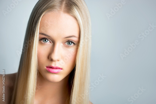 Beautiful young woman with a long hair