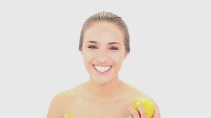 Beautiful model holding two orange halves