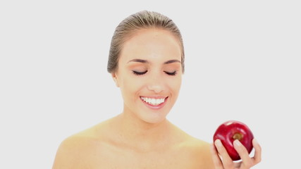 Beautiful model holding an apple
