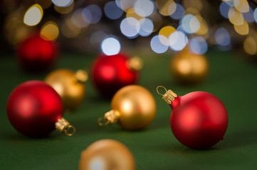 Christmas red balls on green background