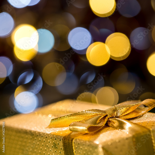Christmas gift with sparkling lights background