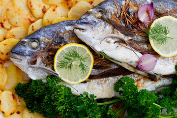 Fish - grilled sea bass with baked potatoes