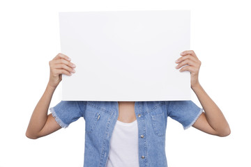Girl holding a blank signboard front of her face