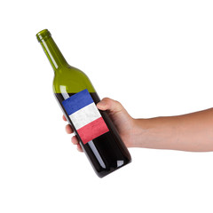 Hand holding a bottle of red wine