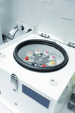 Centrifuge with pathology blood tubes for spinning poster