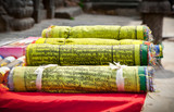 Buddhist Tibetan prayer flags rolled into a roll