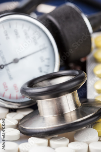 Pills, stethoscope and sphygmomanometer