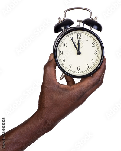 Man holding alarm clock isolated on white
