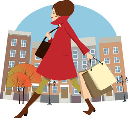 Woman going shopping in the autumn city