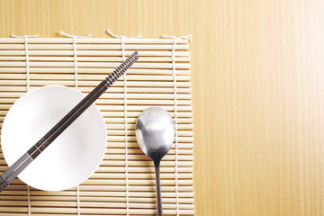 Asian dish place setting on bamboo mat, Korean style