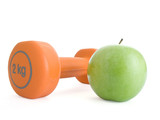 Fitness dumbbell and an apple.
