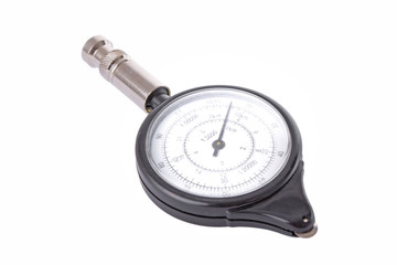 Analogue map measurer isolated on a white background.